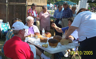 A gathering of people enjoy themselves at the Bread Fest. Click the photo to see a closer view.